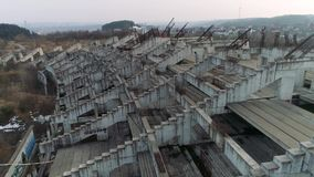 Close up ruins of a large football stadium construction. Drone footage. HD stock video footage