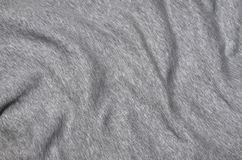 Close-up of rumpled heater and knitted sport jersey or hoodie fabric textured cloth background with delicate striped patter. N Stock Photo