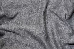 Close-up of rumpled heater and knitted sport jersey or hoodie fabric textured cloth background with delicate striped patter. N Royalty Free Stock Photography