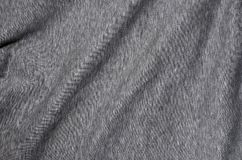 Close-up of rumpled heater and knitted sport jersey or hoodie fabric textured cloth background with delicate striped patter. N Royalty Free Stock Photos