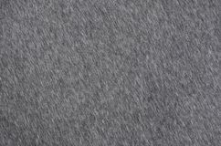 Close-up of rumpled heater and knitted sport jersey or hoodie fabric textured cloth background with delicate striped patter. N Stock Photography