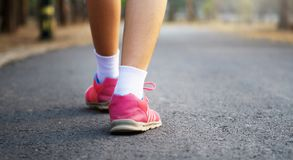 close up runer woman feet on road royalty free stock images