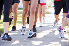 Close Up Of Runners Feet On Suburban Street Stock Photography