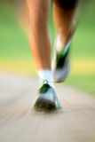 Close up of runners legs in a park Stock Photo