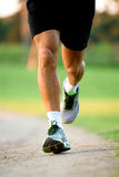 Close up of runners legs in a park Stock Photos