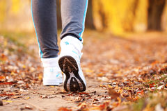 Close-up running feet outdoors. Close-up running feet outdoors, jogging concept Royalty Free Stock Image