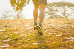 Close up of running man for excercise on the road in morning.  Royalty Free Stock Images