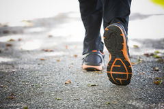 Close up of running shoes on asphalt Royalty Free Stock Photography