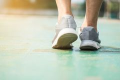 Close up running shoes with legs of athlete. Workout outdoor concept royalty free stock photography