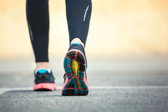 Close up of running shoes on road. Rear view royalty free stock photo