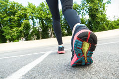 Close up of running shoes on road. Stock Photos
