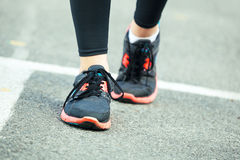 Close up of running shoes on road. Stock Images