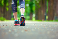 Close up of running shoes on road. Rear view royalty free stock photos