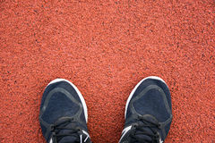 Close up running shoes on running track at sport stadium Royalty Free Stock Photos
