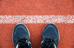Close up running shoes on running Track White Lines at sport stadium Stock Photography