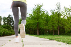 Close up of running woman Stock Image