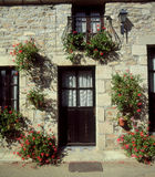 Rural French cottage with hanging baskets, Brittany France Royalty Free Stock Photo