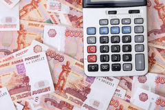 Close-up of russian banknotes (Five Thousand Ruble Notes) and calculator Stock Photo