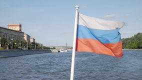 Russian flag on boat moving along river stock video