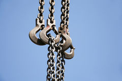 Close up of rusted hanging chain and blue sky Royalty Free Stock Photo