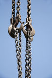 Close up of rusted hanging crane chain and blue sky Stock Photo