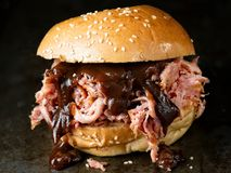 Rustic american barbecued pulled pork sandwich. Close up of rustic american barbecued pulled pork sandwich royalty free stock image