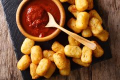Close up of rustic golden potato tater tots and ketchup. Horizon. Close up of rustic golden potato tater tots and ketchup on the table. horizontal top view from Stock Images