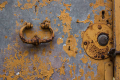 Close up of rustic old door with cracked red paint and grunge Stock Photography
