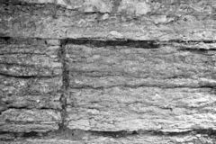 Close up on a rustic stone wall royalty free stock photo