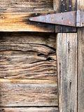 Close up of rustic wooden gate with rusty hinge stock images