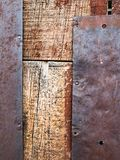 Close up of rustic wooden wall with rusty metal plates royalty free stock photos