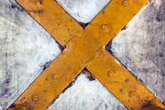 Close up of Rustic Yellow Metal Cross Stock Images