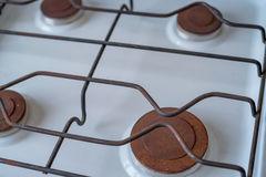 Close up rusty burneres on modern stove Royalty Free Stock Photo