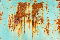 Close up of rusty flaking steel plate with light blue color. stock photos