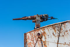 Close-up of rusty harpoon gun in bows Stock Photography