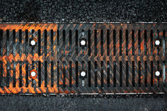 Close up of rusty iron grate. On the road. Iron drain Stock Images