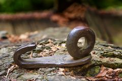 Close up of an iron hook embedded in a rock. A close up of a rusty iron hook embedded in a rock Royalty Free Stock Photography