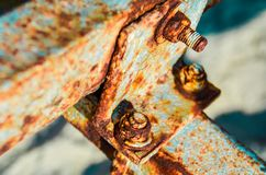 Close up of rusty metal parts of mechanism detail. Rusty nuts and bolts texture stock photography