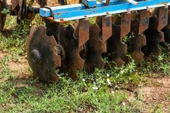 Rusty old disc harrow in backyard close stock photo