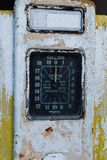 Close up of a rusty old yellow petrol pump. Close up of a rusty old single yellow petrol pump, with a large dial showing gallons royalty free stock image
