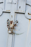 Close up of rusty white gate with lock Stock Image