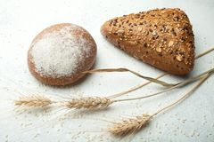 Close-up, rye-wheat whole-wheat bread on a white background royalty free stock images