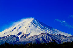 Close up of sacred mountain of Fuji on  top covered with snow in Stock Photo