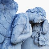 Close up sad angels symbol of death. Fragment of an antique statue stock image