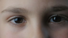 Close-up of a sad boy eyes stock footage