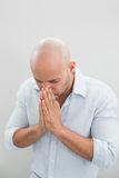 Close up of a sad casual man with hands to his face Royalty Free Stock Photo