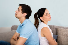 Close Up Of Sad Couple Sitting Back To Back. On Sofa At Home Royalty Free Stock Image