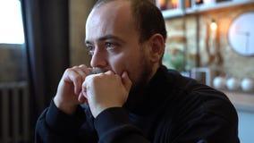Close up sad and depressed caucasian man in the dark,