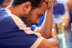 Close up of sad football fan at bar or pub Royalty Free Stock Photo