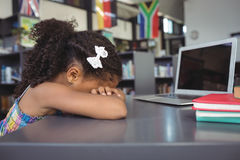 Close up of sad girl in library Royalty Free Stock Images